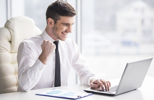 37257994 - young, happy businessman is working in his office.
